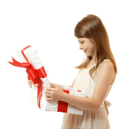 open present: happy little girl open box with christmas present, isolated on white background Stock Photo