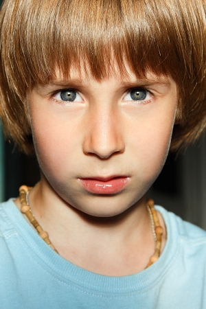 blond boy: expressive portrait of little boy Stock Photo