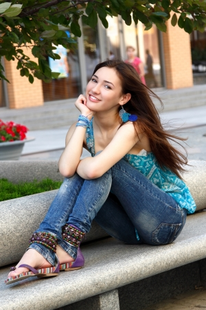 Outdoors street portrait of beautiful young brunette girl photo