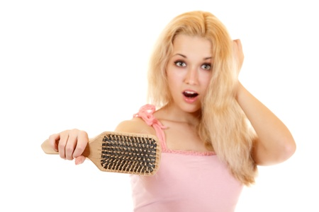 alopecia: women with hair broblem holding loss hair comb in hand, isloated on white background Stock Photo