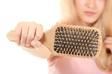 comb hair: women with hair broblem holding loss hair comb in hand, isloated on white background Stock Photo