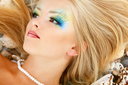 fantasy makeup: teenager girl mermaid beautiful make-up