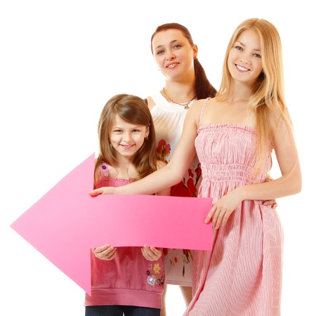 sudio: mother with two daughters happy smiling holding pink arrow, isolated on white background