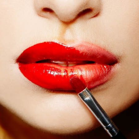 female lips with red lipstick makeup closeup photo