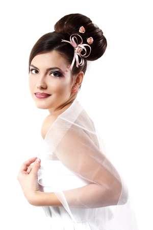 hair bow: beauty young bride with beautiful makeup and hairstyle in veil over white background
