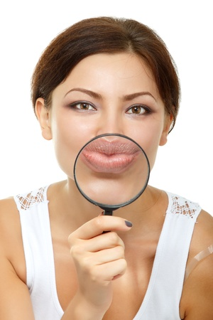 big women: Smiling attractive give kiss through a magnifying glass over white background