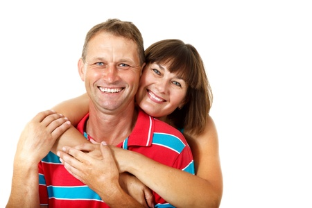 Happy caucasian family having fun and smiling over white. Wife hugs her husband photo