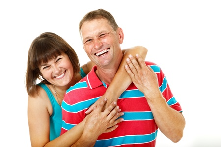 average age: Happy caucasian family having fun and smiling over white. Wife hugs her husband