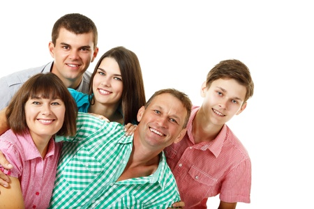 having fun: Happy large caucasian family having fun and smiling over white background.