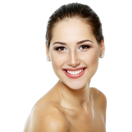 Beauty portrait of beautiful cheerful young fresh woman, face and shoulders closeup. Isolated on white background  photo