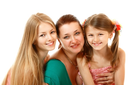 happy mother with two daughters, isolated on white background photo