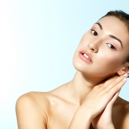beautiful youg fresh woman looking at camera, beauty face over blue background Stock Photo - 16761735