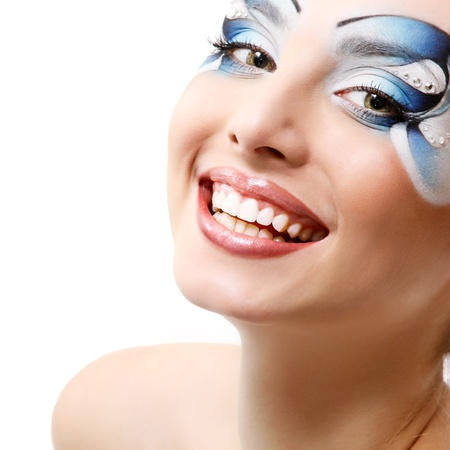 young woman with beautiful water makeup smiling over white background photo