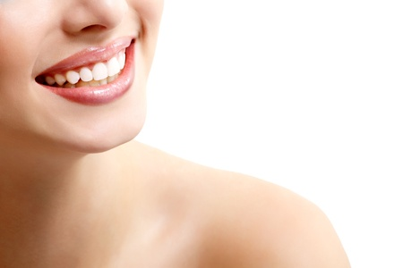 Beautiful wide smile of young fresh woman with great healthy white teeth. Isolated over white background  photo