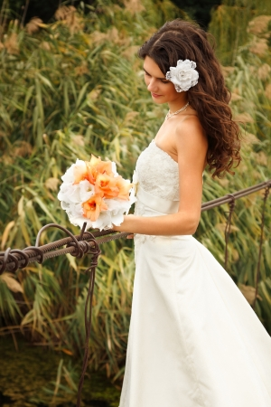 young beautiful woman bride's portrait on the bridge, summer nature outdoor Stock Photo - 16764593