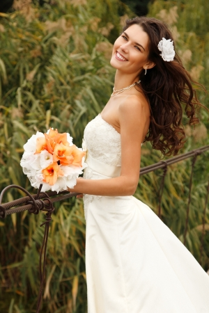 young beautiful woman bride's portrait on the bridge, summer nature outdoor Stock Photo - 16764284
