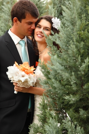 happy beautiful young bride with groom in love summer nature outdoor photo