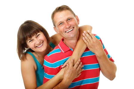 Happy caucasian family having fun and smiling over white. Wife hugs her husband, isolated photo