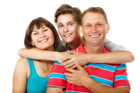 parent and teenager: Mother, father with son teenager. Happy caucasian family having fun and smiling over white background.  Stock Photo