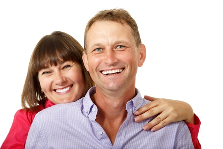 average woman: Attractive cheerful woman with man in love smiling over white background. Portrait of happy mature wife hugs her husband, isolated