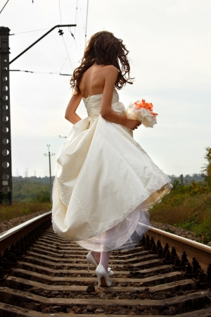 young woman bride's walks on the railway, summer nature outdoor, back view Stock Photo - 16748349