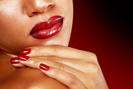 Young woman face detail closeup, mulatto fresh fashion girl with vivid red lips. Isolated photo