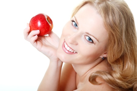 beautiful smiling woman holding red apple, mid adult female face and shoulders closeup, isolated on white background Stock Photo - 16879905