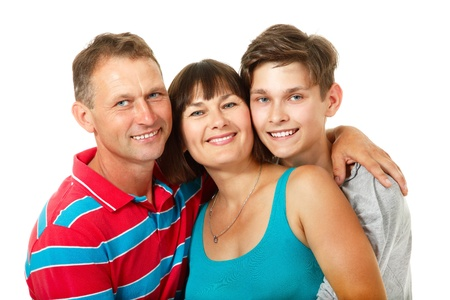 mid adult couple: Mother, father with son teenager. Happy caucasian family having fun and smiling over white background.  Stock Photo
