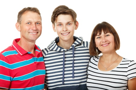 Mother, father with son teenager. Happy caucasian family having fun and smiling over white background.  Imagens