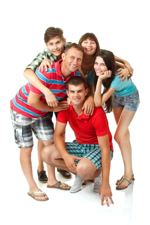 Happy big caucasian family having fun and smiling over white background. Mother, father and children - daughter with her husband and son teenager photo