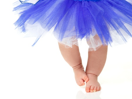 belly dancing: baby girl like a ballet dancer in blue tutu, isolated on white background Stock Photo