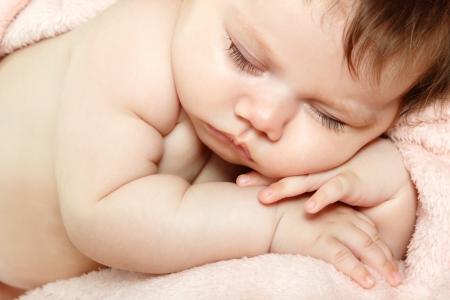 1 2 month: cute sleeping baby, beautiful kids face closeup, studio shot