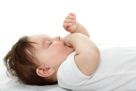 1 2 month: cute infant sleeping and sucking finger, beautiful kids face closeup, studio shot