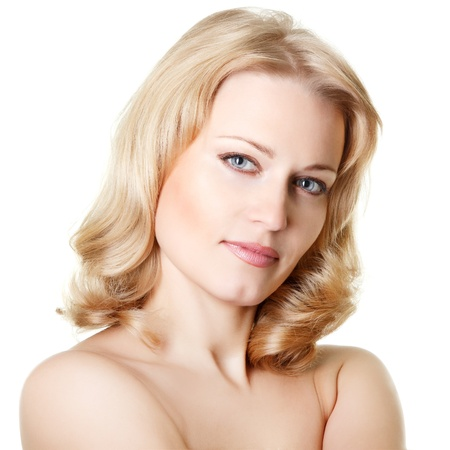 beautiful woman looking at camera, mid adult female face and shoulders closeup, isolated on white background photo