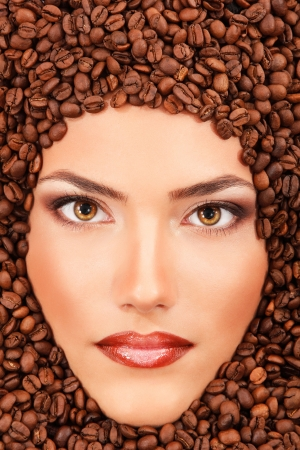 young beautiful woman face with coffee and perfect make-up photo