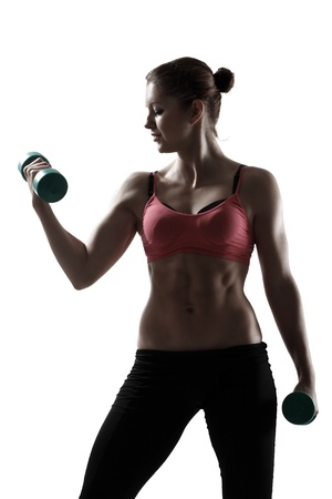 out of body: sport woman doing exercise with dumbbells, silhouette studio shot over white background