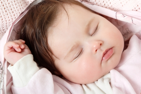 cute infant sleeping, beautiful kids face closeup, studio shot photo