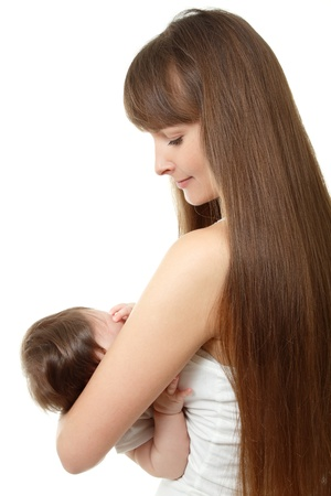 young mother breast feeding her infant over white background photo
