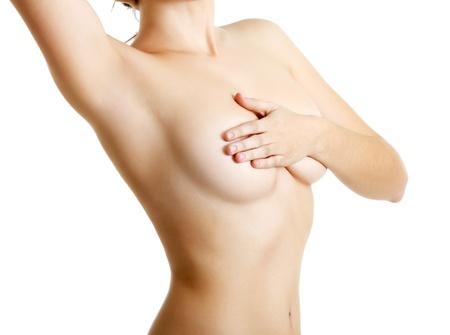 corps femme nue: mastopathie du sein ou le cancer examinant femme sur blanc