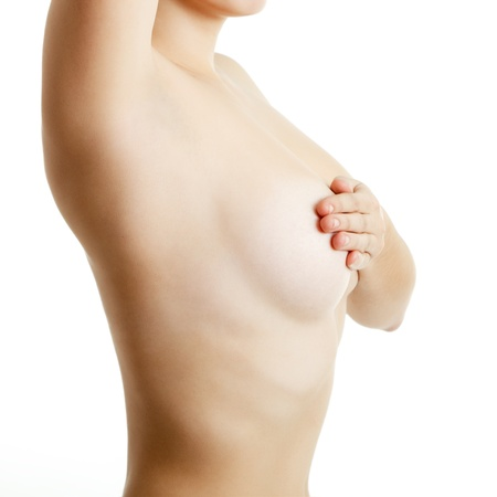 woman examining breast mastopathy or cancer over white photo