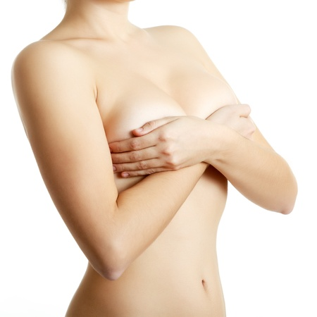 nude breast: woman examining breast mastopathy or cancer isolated