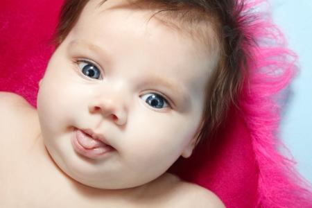 1 2 month: cute baby surprised, beautiful kids face closeup, studio shot