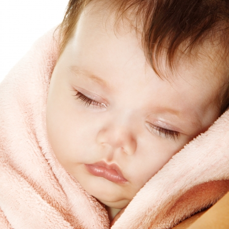 cute sleeping baby, beautiful kids face closeup, studio shot photo