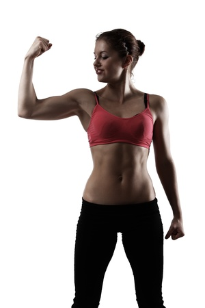 sport woman doing exercise, silhouette studio shot over white background photo