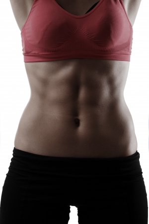 tummy: abs press of sport young woman closeup, silhouette studio shot over white background