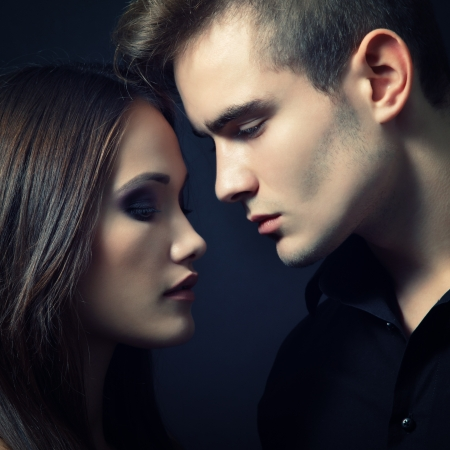 Sexy passion couple, beautiful young man and woman closeup, studio shot over black Stock Photo - 17631968