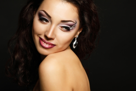 Young fresh luxury woman with beautiful makeup, beauty female portrait, face closeup over black photo