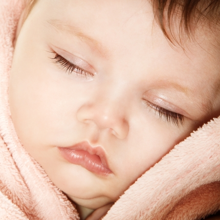 cute infant baby sleeping, beautiful kids face closeup, studio shot photo
