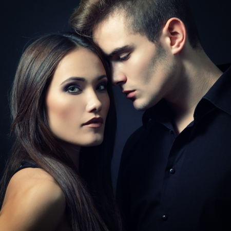 Sexy passion couple, beautiful young man and woman closeup, studio shot over black Stock Photo - 18207667