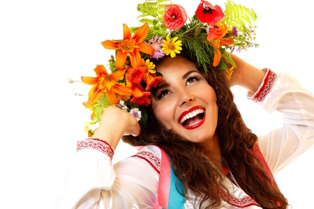 slavic: Beautiful ukrainian young woman in garland of summer flowers and native costume dancing on Slavic holiday Ivan-Kupala, on white background Stock Photo